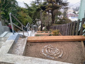 Photo: View from the top of the Hidden Garden Steps site (16th Avenue, between Kirkham and Lawton streets in San Francisco's Inner Sunset District) as Michael Hemes finishes trimming back shrubs on October 22, 2013--two days before installation of the 148-step Hidden Garden Steps ceramic-tile mosaic designed and created by artists Aileen Barr and Colette Crutcher is scheduled to begin. For more information about this volunteer-driven community-based project supported by the San Francisco Parks Alliance, the San Francisco Department of Public Works Street Parks Program, and hundreds of individual donors, please visit our website at http://hiddengardensteps.org.