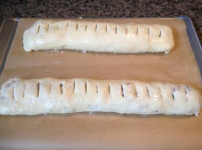 Place both jelly rolls on parchment lined cookie sheet. Cut slits in dough at...