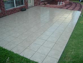 Photo: Outdoor patio floor installation in 12x12 ceramic tile.