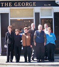 Photo: Outside the George Hotel, Portsmouth, England, May 2012. l to r: Cheril Cheverton, Liz Sweet, Suzan Alexander, George Helffrich, Mike Alexander, Jeff Ogden, and Shifrah Nenner. Photographer: Scott Gerstenberger (not shown)