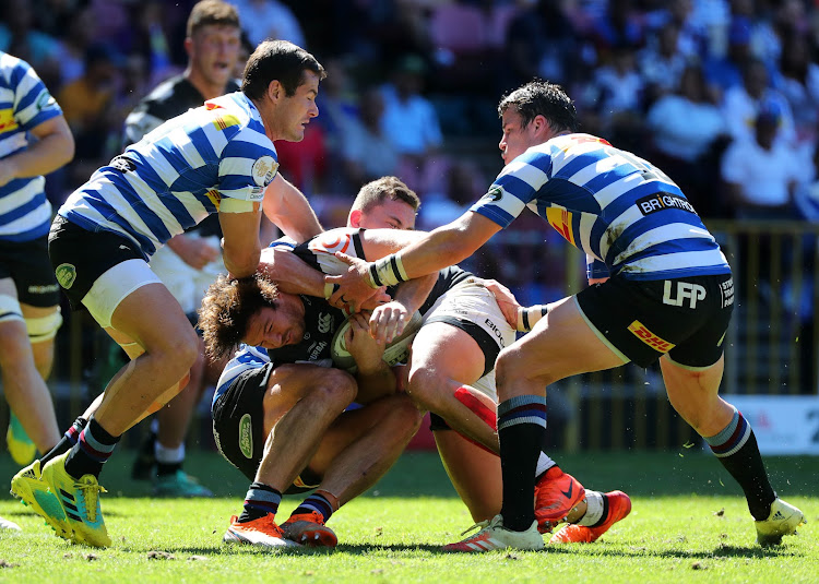 Marius Louw of the Sharks tackled by Dan Kriel of Western Province during the 2018 Currie Cup Rugby match between Western Province and The Sharks at Newlands Stadium, Cape Town on 29 September 2018.