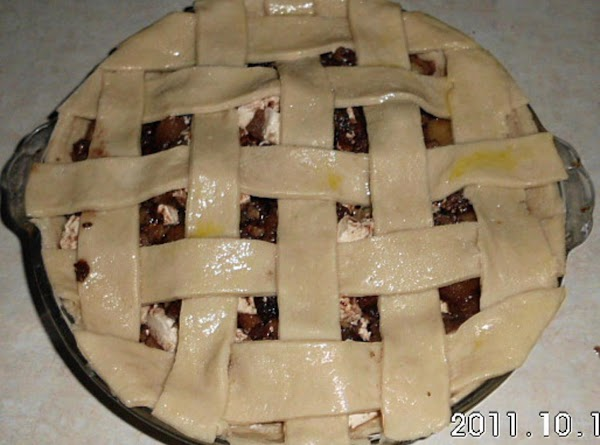 Brush lattice top with egg wash and sprinkle with white sugar.  Bake 375°...