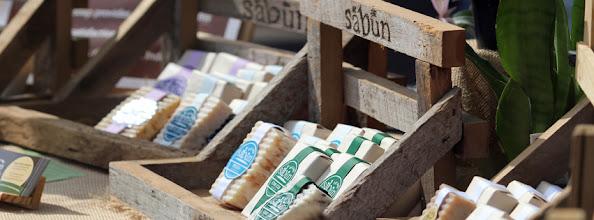 Photo: Sabun soaps displayed in handmade custom wood display.