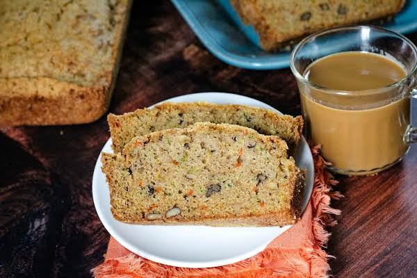 Two Slices Of Zucchini Carrot Bread With A Cup Of Coffee.