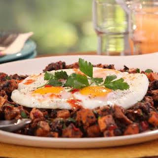 Jerk Pork Belly and Sweet Potato Hash with Fried Eggs.
