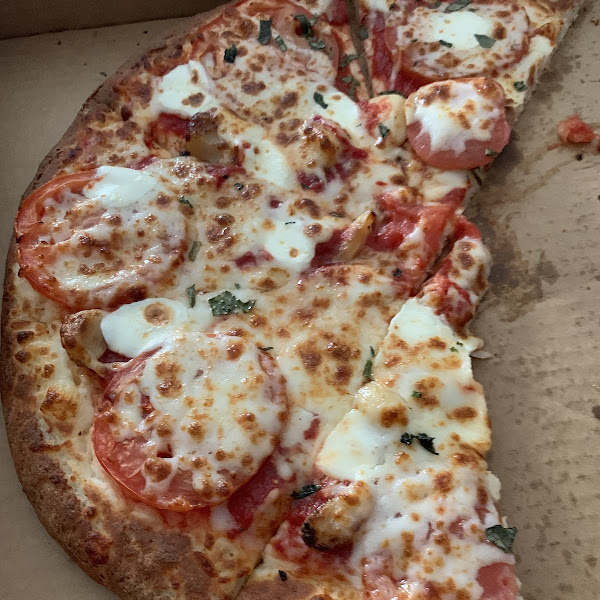 Tomatoes, basil, garlic and mozzarella cheese on this fabulous gfree crust.