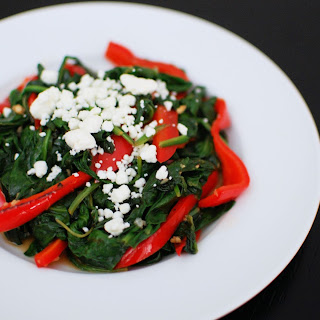 Spinach with Pan Roasted Red Peppers and Goat Cheese.