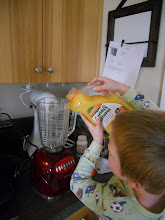 Photo: Nathan added the juice, watching the measurements on the side of the blender.