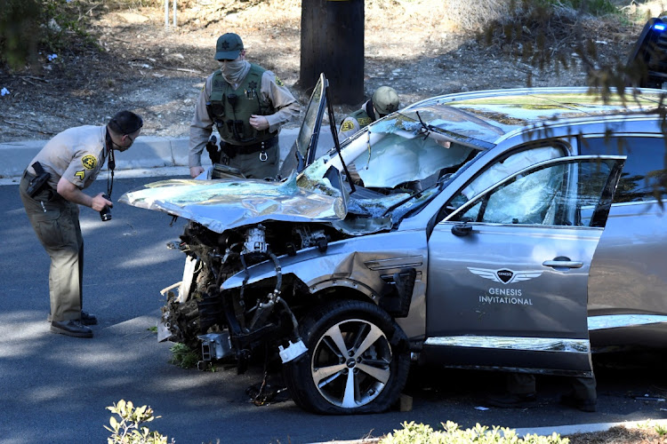 Officers inspect the vehicle of golfer Tiger Woods after his accident in Los Angeles, California, the US, February 23 2021. Picture: REUTERS/GENE BLEVINS