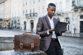 A person holding a briefcase  Description automatically generated with medium confidence