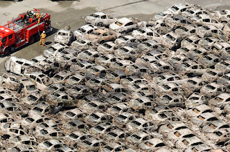Photo: Burned-out cars are pictured at Hitachi Harbour in Ibaraki Prefecture in northeastern Japan March 12, 2011. Japan confronted devastation along its northeastern coast on Saturday, with fires raging and parts of some cities under water after a massive earthquake and tsunami that likely killed at least 1,000 people. REUTERS/Kyodo  (JAPAN - Tags: DISASTER TRANSPORT BUSINESS) FOR EDITORIAL USE ONLY. NOT FOR SALE FOR MARKETING OR ADVERTISING CAMPAIGNS. THIS IMAGE HAS BEEN SUPPLIED BY A THIRD PARTY. IT IS DISTRIBUTED, EXACTLY AS RECEIVED BY REUTERS, AS A SERVICE TO CLIENTS. JAPAN OUT. NO COMMERCIAL OR EDITORIAL SALES IN JAPAN
