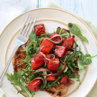 Baked Chicken Milanese with Arugula and Tomatoes.