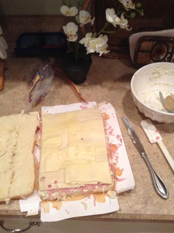 Top with ham ,cheese, and remaining half of rolls. Slice through to cut the...