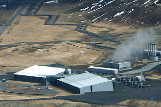 Photo: Aerial view of Hellisheiði Power Plant. Note that the pipes (top center) carrying hot water from the plant are angled to allow for expansion.