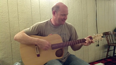 Photo: Eric playing a custom guitar he made.