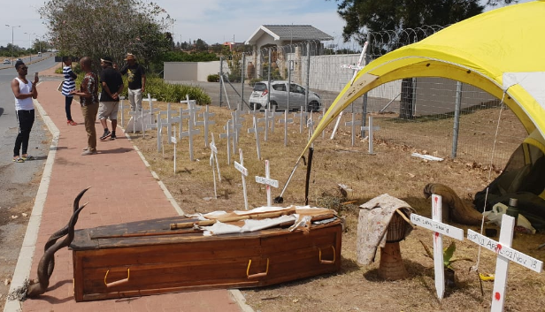 Christian Martin's coffin amid dozens of crosses outside the Eastern Cape government offices in Bhisho.