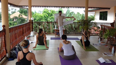Photo: Daniel Fonseca demonstrating Hastapadangushtasana II (Hand to Toe Pose 2) during Asanas class.