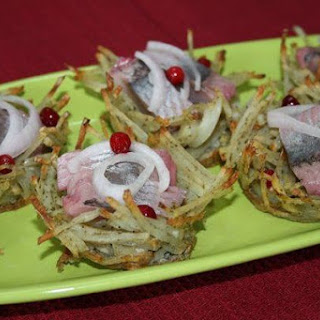 Baskets Of Potatoes With Herring And Cucumber.
