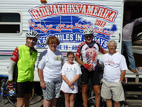 Photo: At our 50 mile rest stop, Dave stopped at a busy gas station. Several people came over to our RV to talk to us or complement us on what we are doing.  This Canadian family wanted to make sure their daughter got to shake our hands, and we took their picture.