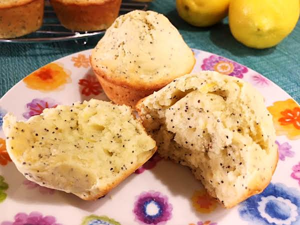 Lemon Poppy Seed Muffins On A Plate.