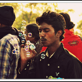 Bubbles by Jaydip Sen - People Street & Candids