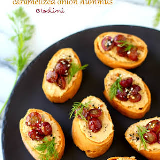 Roasted Grape Caramelized Onion Hummus Crostini.