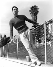 Photo: John Payne was a good-looking romantic lead.  His physique could be showed off in casual ways--e.g., by suggesting we have caught him casually about to play tennis.  The clothes emphasize his v-shaped torso and long legs.