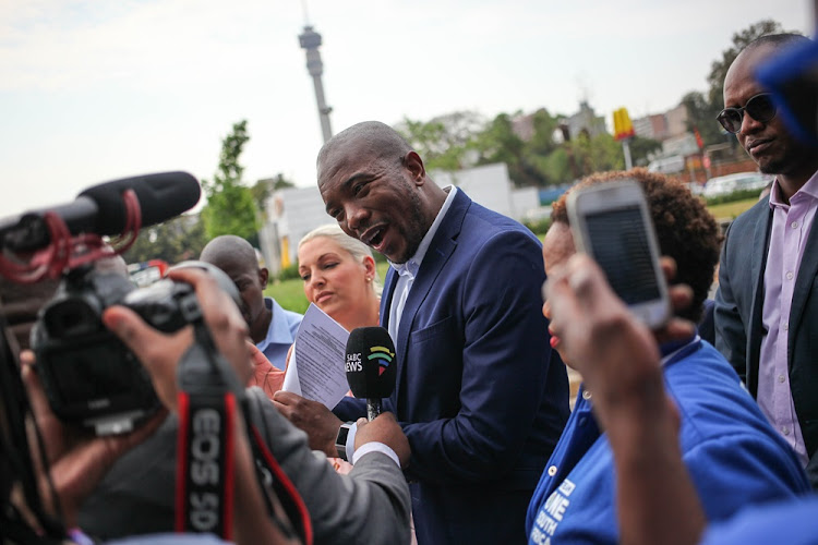 Leader of the Democratic Alliance, Mmusi Maimane, talks to members of the media in Parktown, Johannesburg on 27 September 2018, before the beginning of the Zondo Commission of Inquiry into state capture.