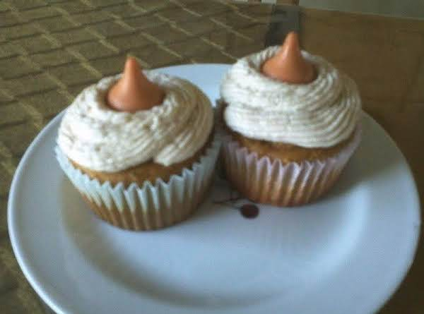 These Are Pumpkin Cupcakes With Marshmallow Cream Filling. Frosted With This Frosting Recipe. Topped With Hershey Pumpkin Spice Kiss.