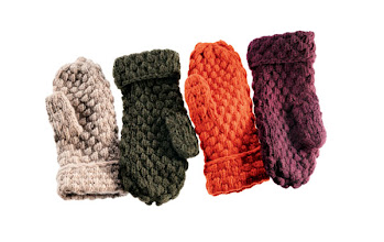 Photo: BERGDORF GOODMAN Cashmere chunky-knit mittens in ivory, green, amber or currant. $175. Also available in black, charcoal, navy, nile brown, pale banana, bloodstone red or royal blue. Imported. First Floor, The Men's Store. 212 339 3290