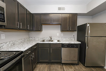 B2R Kitchen with Stainless Steel Appliances and Dark Cabinets