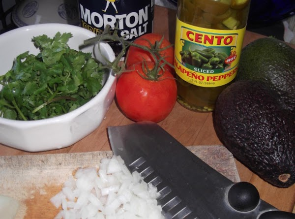 Finely chop onion, cilantro, and jalapenos (remove seeds).