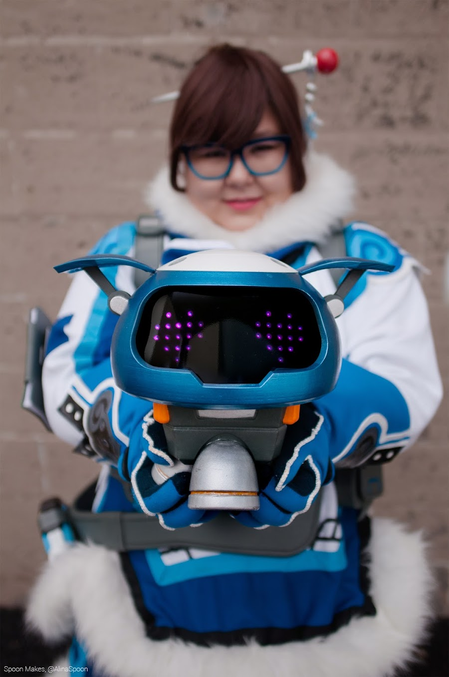 Alina as Mei from Overwatch, with her sidekick, Snowball