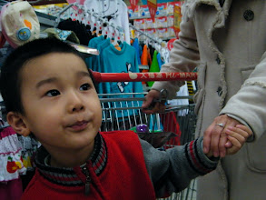 Photo: baby browsing goods.