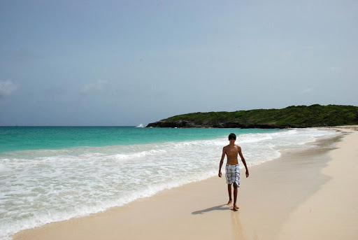 Walking an isolated beach on Vieques Island in Puerto Rico.
