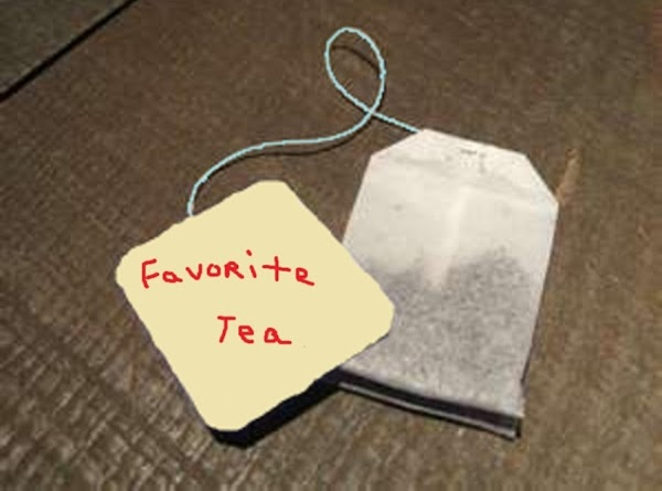 Remove tea bags from envelopes.  Dip the tea bags into the hot water...