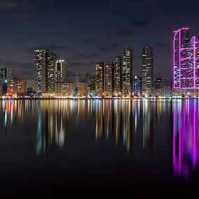 Al Madjaz Park at Night by Ricky Pagador - City,  Street & Park  City Parks ( city scape, skyline, reflection, park, skyscraper, cityscape, city park, nightscape )