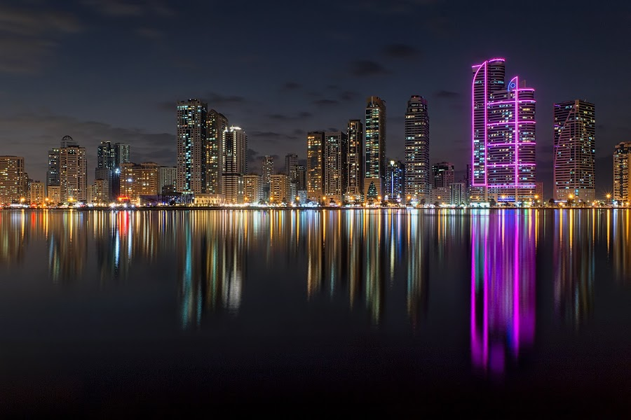 Al Madjaz Park at Night by Ricky Pagador - City,  Street & Park  City Parks ( city scape, skyline, reflection, park, skyscraper, cityscape, city park, nightscape )