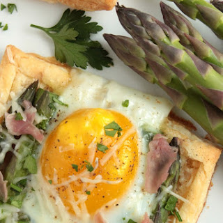 Individual Asparagus and Egg Tarts with Parmesan and Prosciutto.