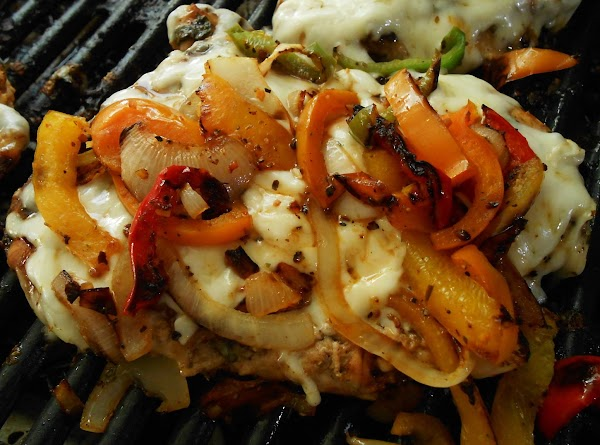 The last few minutes of cooking chicken place grated cheese and veggies on top...