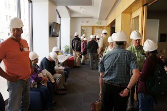 Photo: Queueing for the tour with hard hats, safefy glasses, and ear protection.