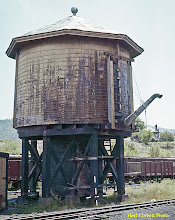Photo: 078-07.  Double spouted water tank (spout on back not visible here).  Spout on back allegedly just a movie prop.  Edge of pump house visible at left.  7/28/60.