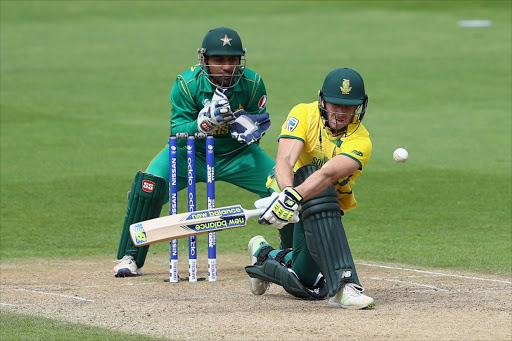 David Miller of South Africa sweeps as wicketkeeper Sarfraz Ahmed of Pakistan looks on during the ICC Champions Trophy match between Pakistan and South Africa at Edgbaston on June 7, 2017 in Birmingham, England.