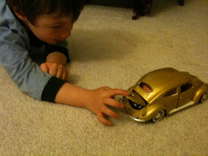 Photo: Clark Plays with Model Beetle