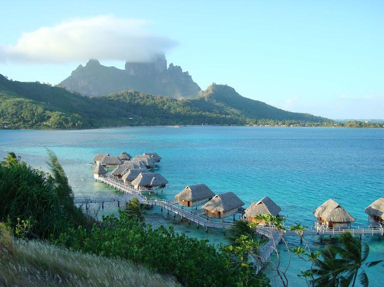 Sofitel Motu on the water in Bora Bora with Mount Otemanu in background.