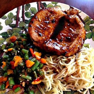 Hoisin-Glazed Pork Chops With Sichuan Green Beans.