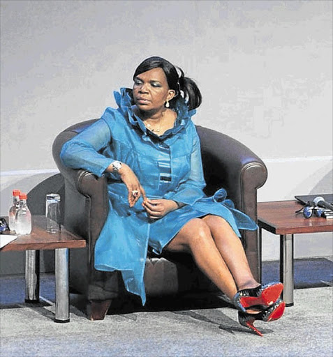 BRIGHT RED: Communications Minister Dina Pule, known for her expensive tastes, in the distinctive Louboutin shoes she wore at the indaba