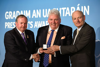 Photo: 6 February 2015; Fergal McCormack, St. Peters Club, Warrenpoint, Co. Down, is presented with his GAA President's Award for 2015 by Uachtarán Chumann Lúthchleas Gael Liam Ó Néill, left, and Denis O' Callaghan, Head of AIB Branch Banking. Croke Park, Dublin Picture credit: Paul Mohan / SPORTSFILE *** NO REPRODUCTION FEE ***