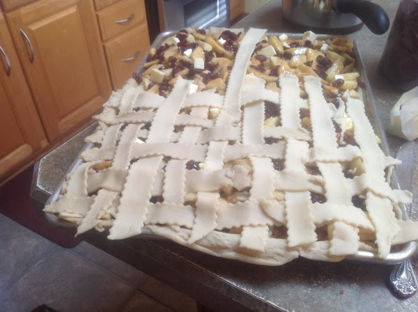Now using a pastry cutter cut strips of dough from the unrolled pastry and...