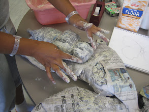 Photo: Davonne Miss M. working on her paper mache butterfly
